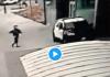 États-Unis : Deux policiers dans leur véhicule se font soudainement tirer dessus par un piéton - VIDEO