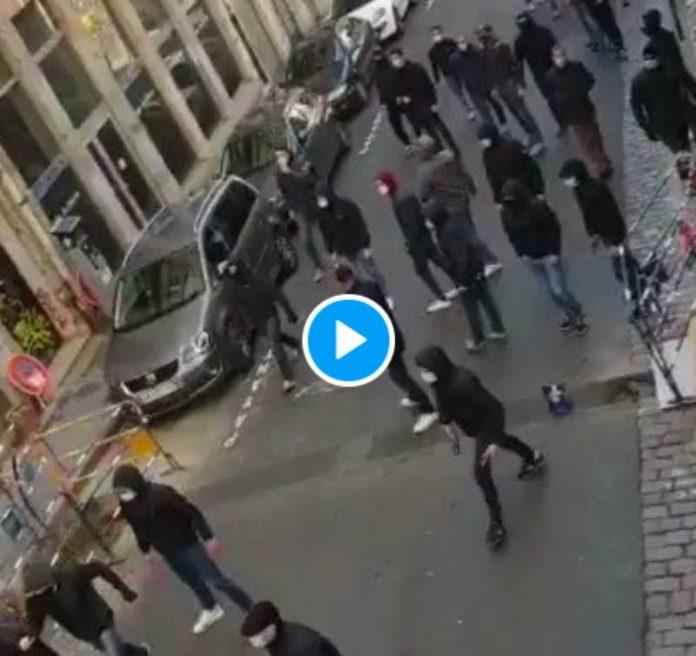 Lyon une meute de fascistes armés et encagoulés attaque une librairie - VIDEO (1)