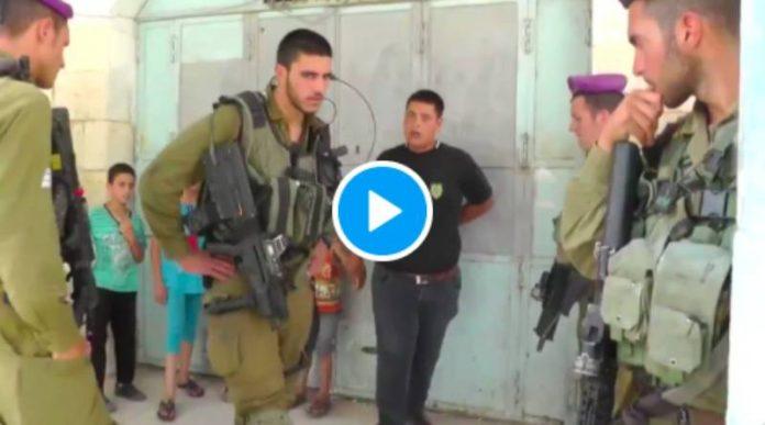 Des soldats israéliens lourdement armés arrêtent un enfant palestinien en pleurs - VIDEO