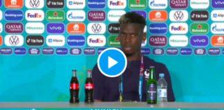 Paul Pogba retire une bouteille de bière en conférence de presse - VIDEO